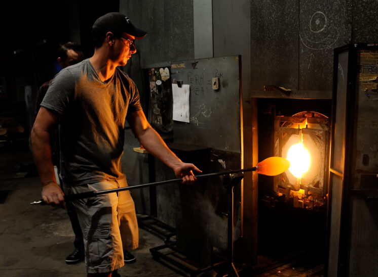 Part of an onsite shoot documenting the fabrication of a very large glass chandelier, one single element's creation, being fired and shaped. Jerry and Lois Photography