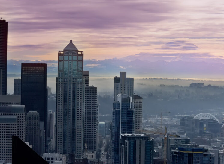 Sunrise in misty pink over Seattle with Mt. Rainier. Jerry and Lois Photography