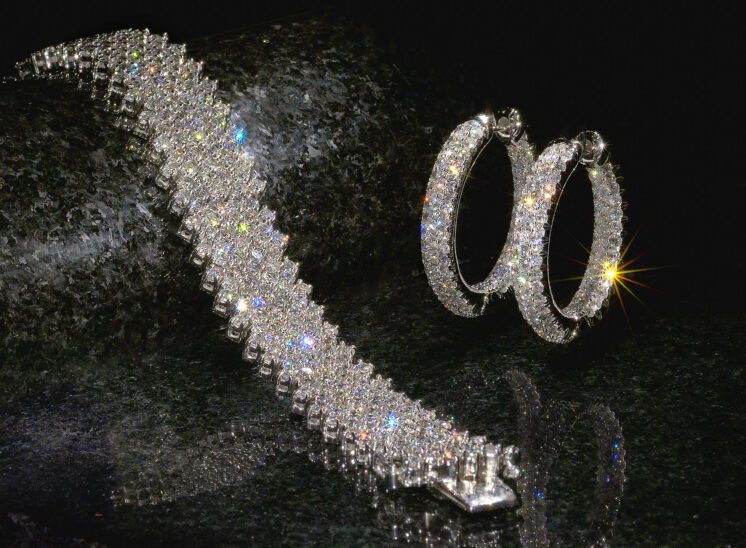 Pave diamond jewelry in a stunning bracelet, with matching diamond earrings
