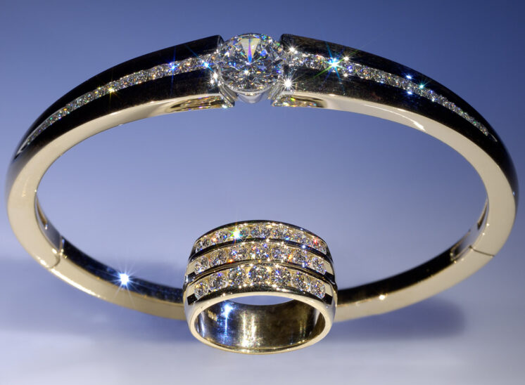 From a series shot with a custom-built, proprietary lighting system designed to capture the inner fire, fine jewelry sparkles for the camera. In this shot, an amazing diamond bangle and ring are paired with brilliant life showcased in the light. Jerry and Lois Photography