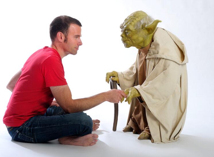 Arik Korman (former Program Manager for The Bob Rivers Show) absorbing wisdom from Master Yoda