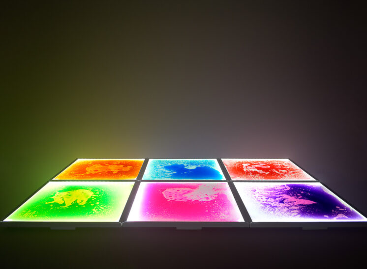 From Playlearn: A group of pressure sensitive, interactive and glowing, colorful, squishy floor tiles. Jerry and Lois Photography