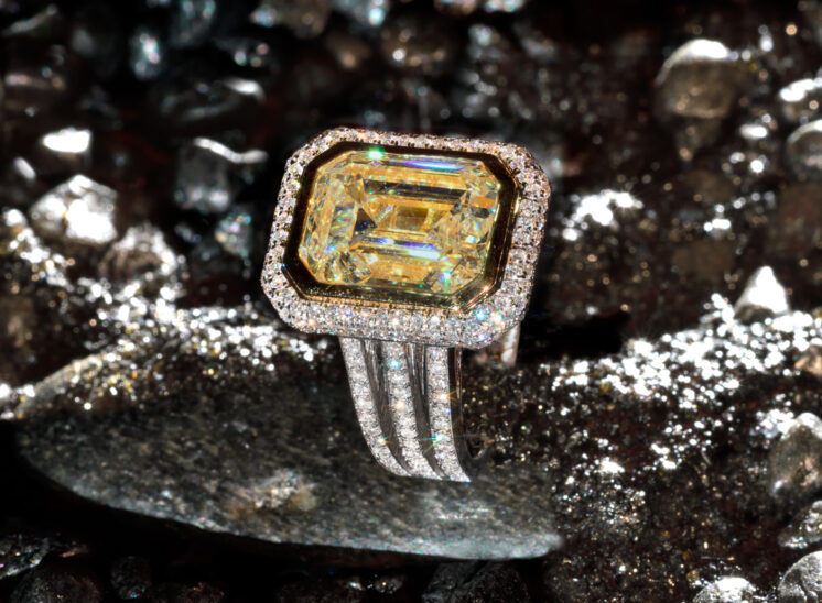 From a series shot with a custom-built, proprietary lighting system designed to capture the inner fire, fine jewelry sparkles for the camera. In this shot, an amazing very large yellow-fancy diamond ring and surrounding diamonds. Jerry and Lois Photography