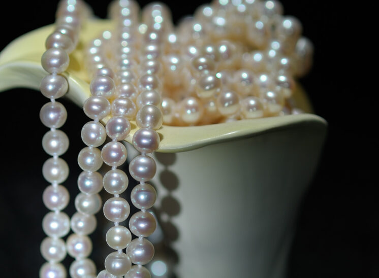 Glowing pearls draped and shaped with a porcelain calla lily. Jerry and Lois Photography