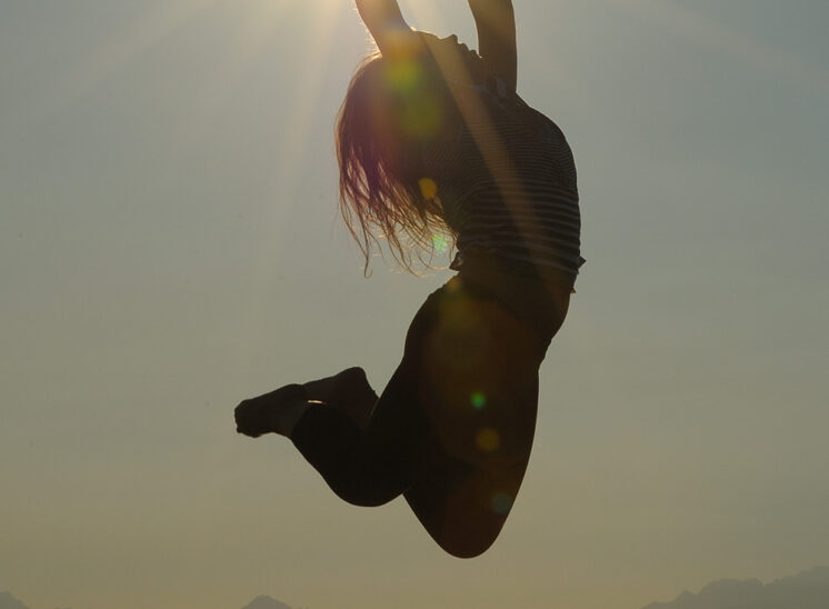 One-click: A gymnast flying up and catching the sun perfectly, graced by the Olympic Mountains and Puget sound for a stunning backdrop. Jerry and Lois Photography