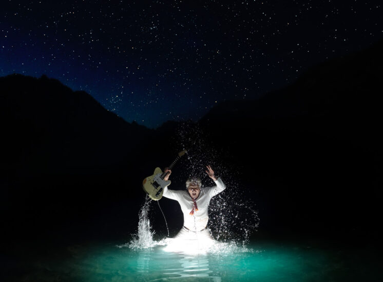 Part of a personal project: Founding Guitarist for the mega group HEART and Rock and Roll Hall of Fame Inductee, Roger Fisher, making a glowing splash in a mountain lake with the Northern Sky above. Jerry and Lois Photography