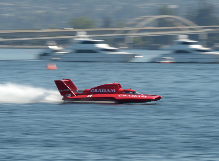 Part of a series during Seattle's Seafair, a speeding hydroplane races by, tack-sharp against motion-blurred surroundings. © Jerry and Lois Photography, all rights reserved