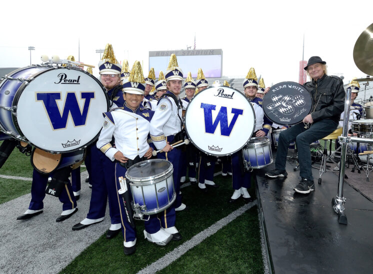Alan White, world-class drummer for YES, John Lennon/Imagine, George Harrison/My Sweet Lord, and Rock and Roll Hall of Fame inductee being honored by the UW Husky Marching Band during their halftime show. © Jerry and Lois Photography