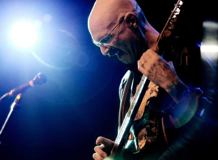 Bassist virtuoso, Tony Levin, (Peter Gabriel, King Crimson, John Lennon, Paul Simon...) in fantastic stage lighting. Jerry and Lois Photography