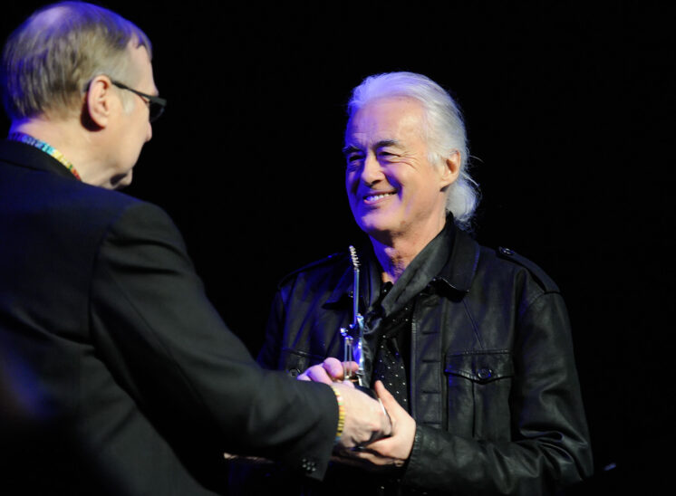 Jimmy receiving EMP/MoPOP Founder's Award from world-visionary Paul Allen. © Jerry and Lois Photography