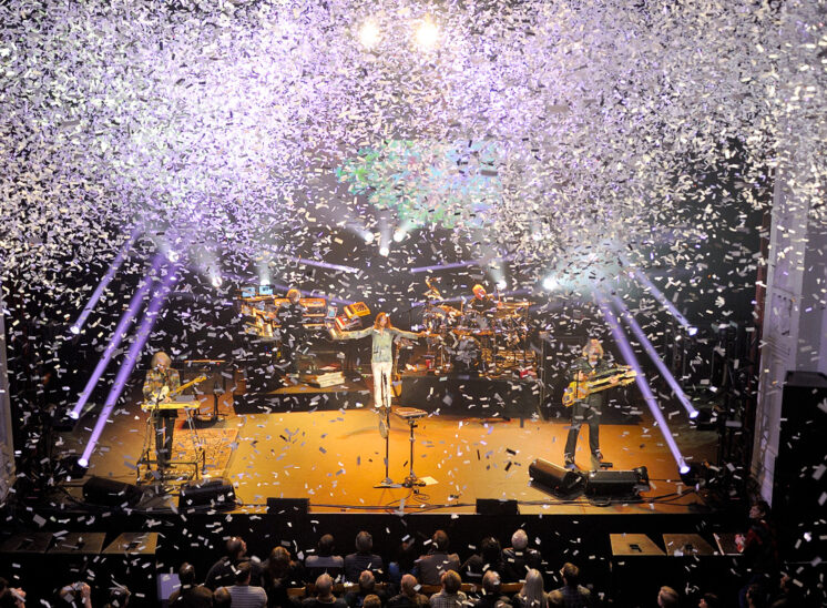 Prog Rock Giants and RRHoF inductees, YES on stage under the descending cloudburst from a confetti cannon. © Jerry and Lois Photography, all rights reserved