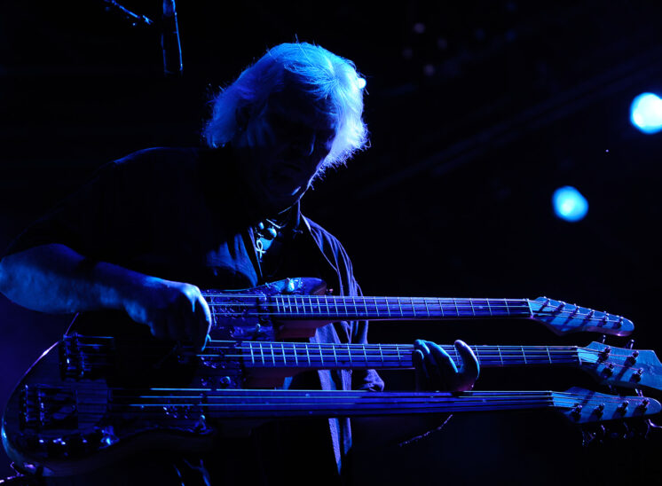 World class, Prog Rock bassist and RRHoF inductee, Chris Squire with his custom triple neck bass in dramatic blue stage light. Jerry and Lois Photography