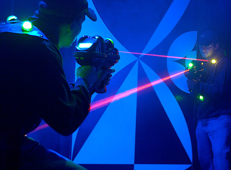 Family entertainment business owners demonstrating their new laser-tag maze. Jerry and Lois Photography