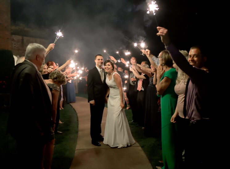Wedding grand finale: Newly weds walk under a canopy of sparklers. Jerry and Lois Photography
