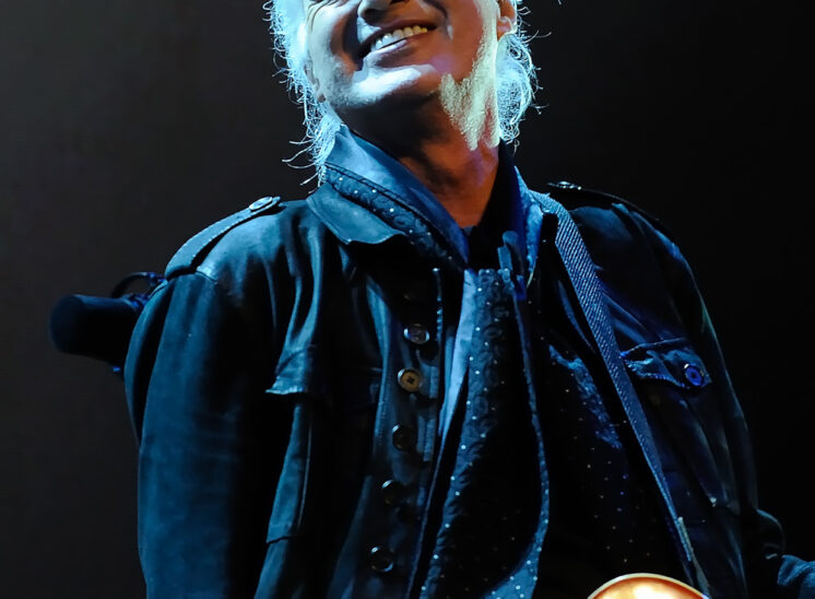 Jimmy Page, a signature moment. © Jerry and Lois Photography